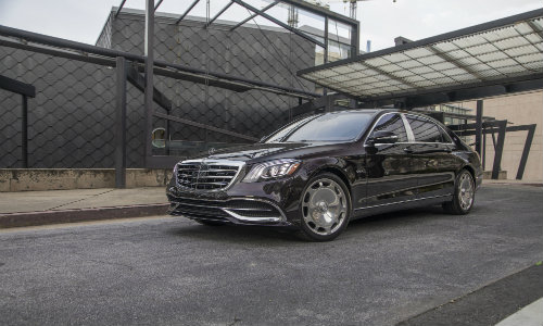 https://blogmedia.dealerfire.com/wp-content/uploads/sites/678/2018/04/2018-Mercedes-Maybach-560-Sedan-parked-outside-an-abstract-art-building-of-metal-on-its-driveway_o.jpg