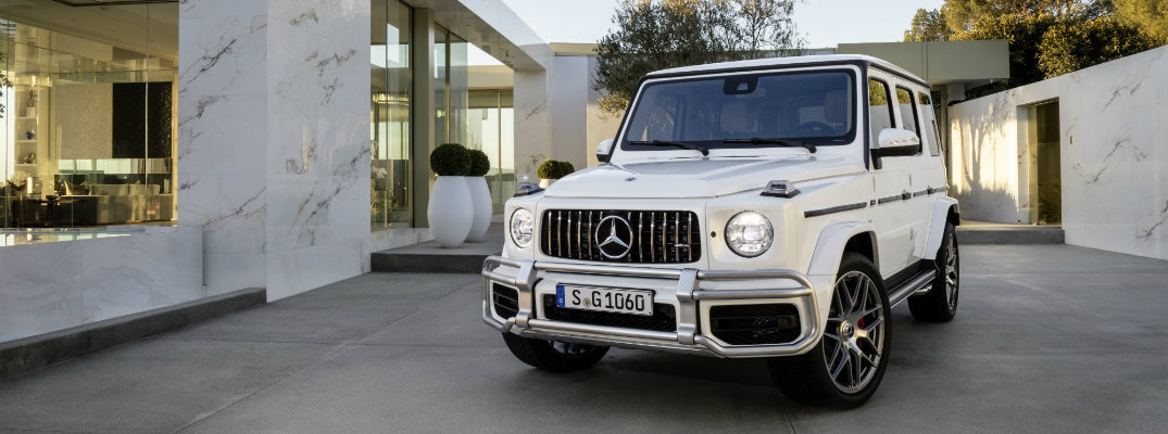 2019 Mercedes-AMG G 63 exterior shot white paint parked in the driveway of a luxury house