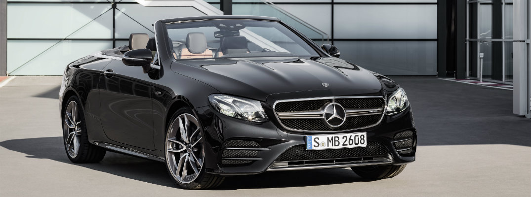 2019 Mercedes-Benz E-Class E 53 cabriolet exterior shot in front of glass paneled building