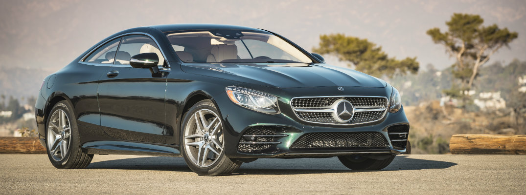 2018 Mercedes-Benz S 560 Coupe exterior shot parked on a gravel clearing with mountains in the background