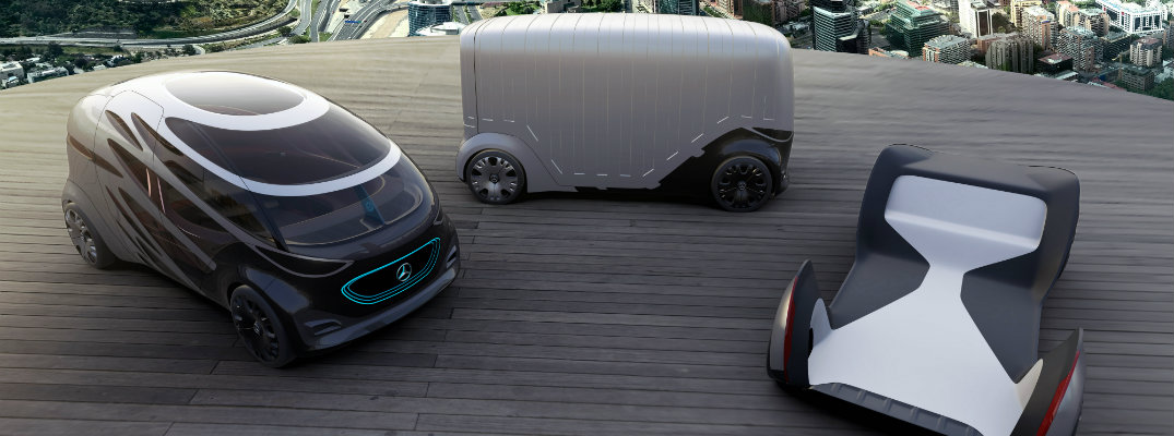 Mercedes-Benz Vision URBANETIC mobility van concepts parked on a rooftop wooden platform