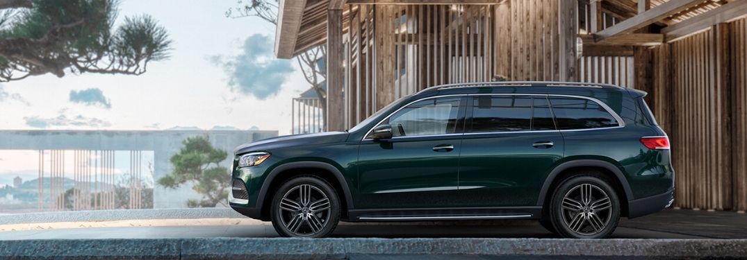 Green 2020 Mercedes-Benz GLS parked in front of house from exterior drivers side