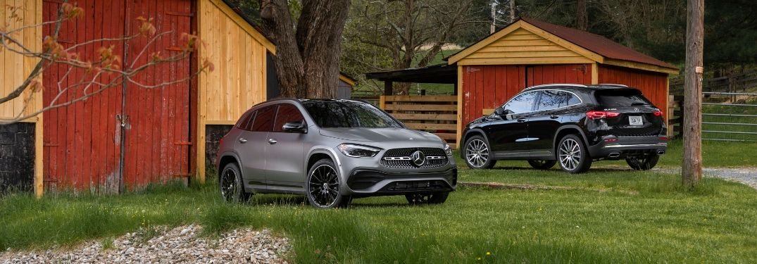Two 2021 Mercedes-Benz GLA models in front of homestead