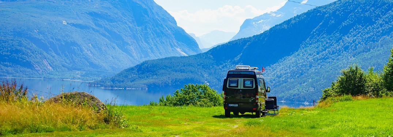 Mercedes-Benz Sprinter Van camper camping in front of mountain