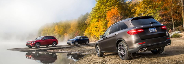 Three Mercedes-Benz GLE models near foggy lake