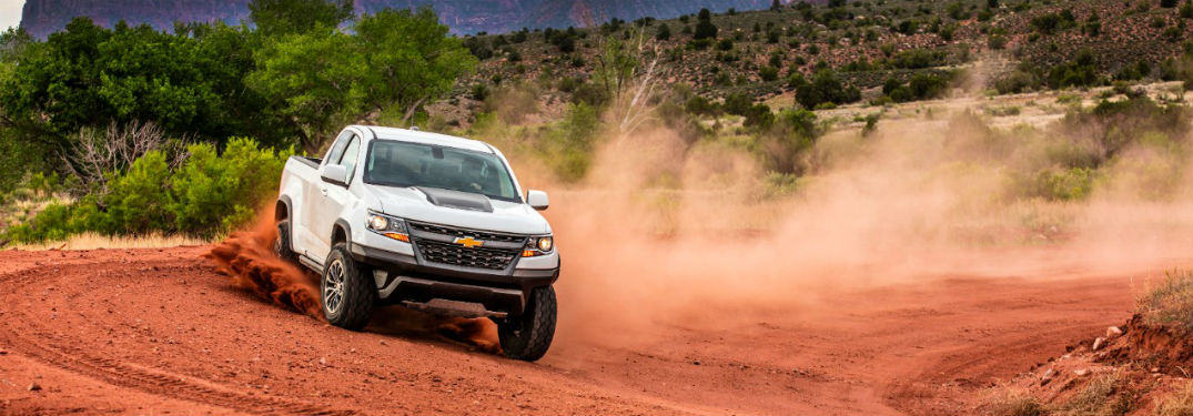 2018 Chevrolet Colorado ZR2 in white driving on dirty dunes