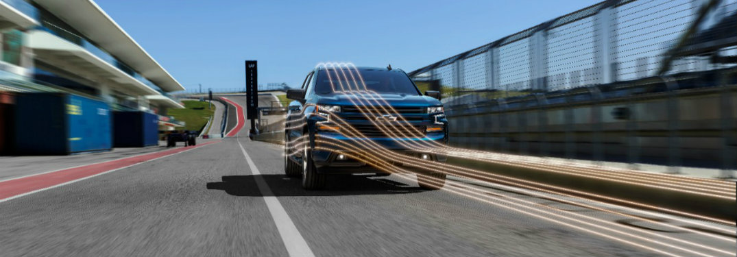 2019 Chevy Silverado driving on the road with lines showing where air currents flow around its grille and side