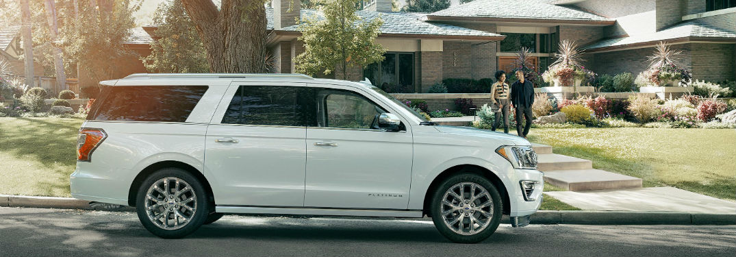 side view of a white 2018 Ford Expedition in front of a house