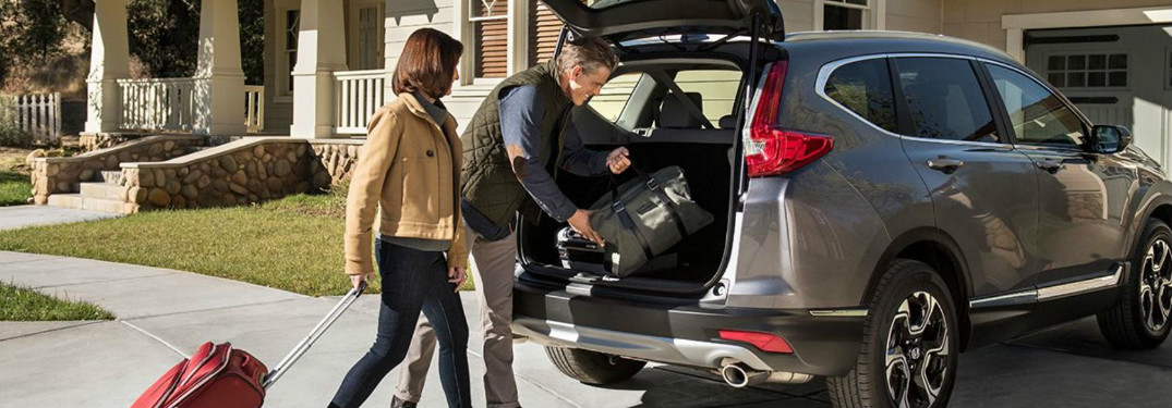 Man and women loading luggage into their 2018 Honda CR-V
