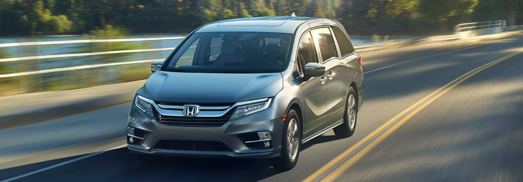 silver 2018 Honda Odyssey driving on open road