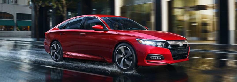 2018 Honda Accord driving on rainy street