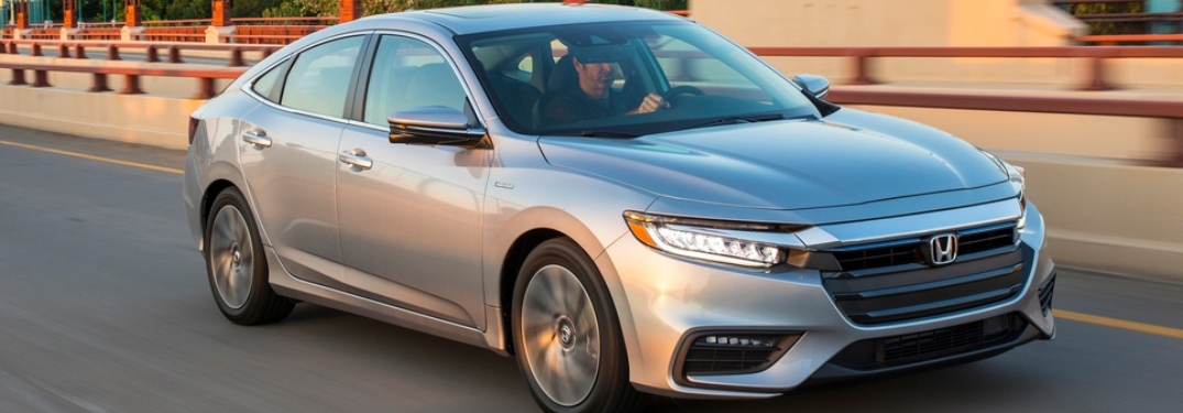 Driver behind the wheel of a silver 2019 Honda Insight