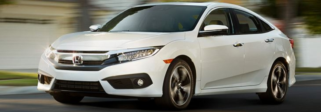 Side view of a white Honda Certified Pre-Owned sedan
