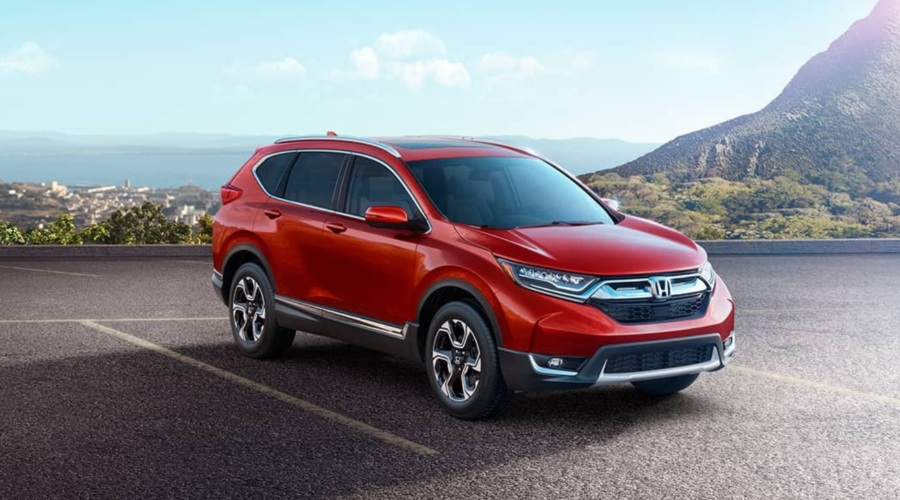 Side view of a red 2018 Honda CR-V