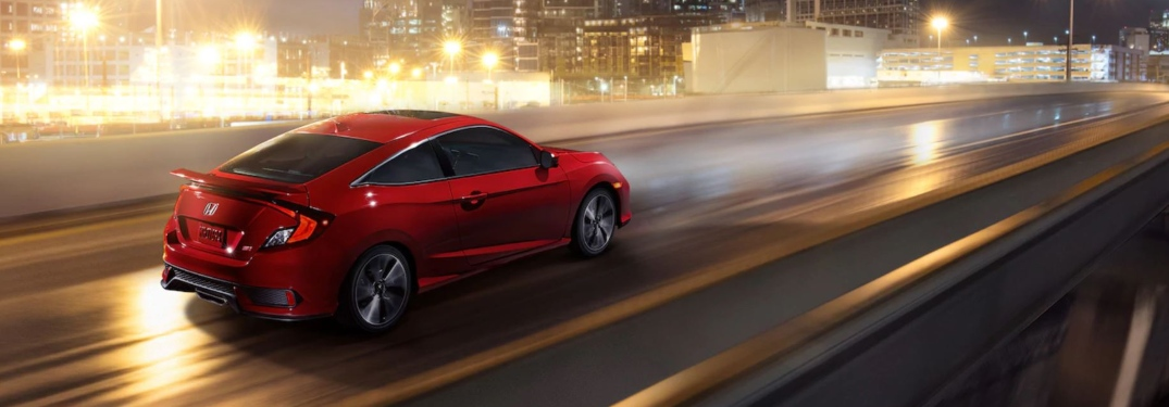 Red 2019 Honda Civic Si Coupe on highway
