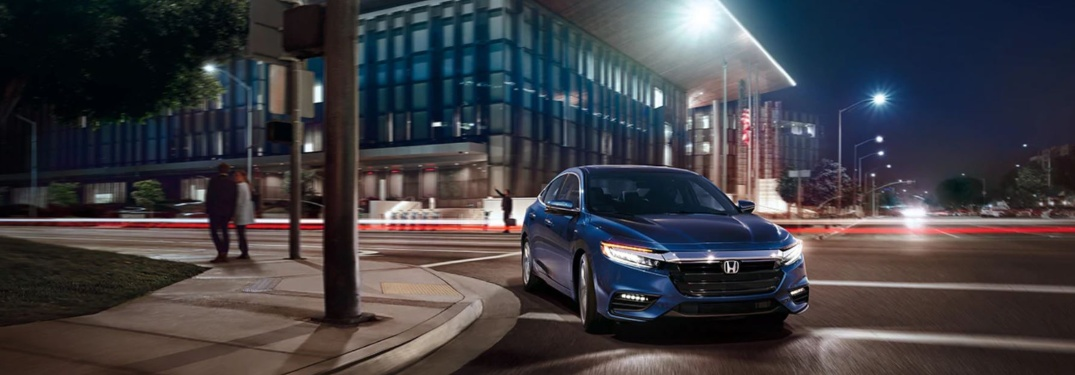 Blue 2020 Honda Insight driving through city at night