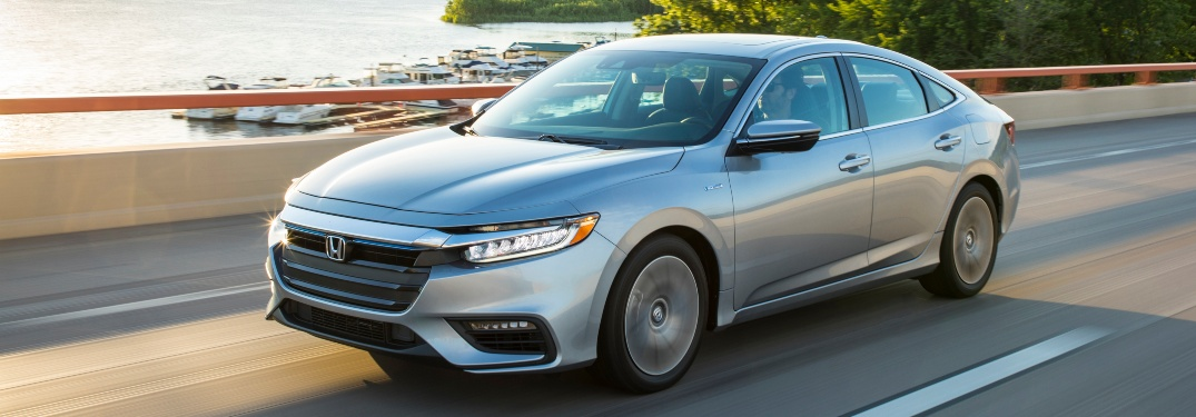 Silver 2020 Honda Insight driving on open road