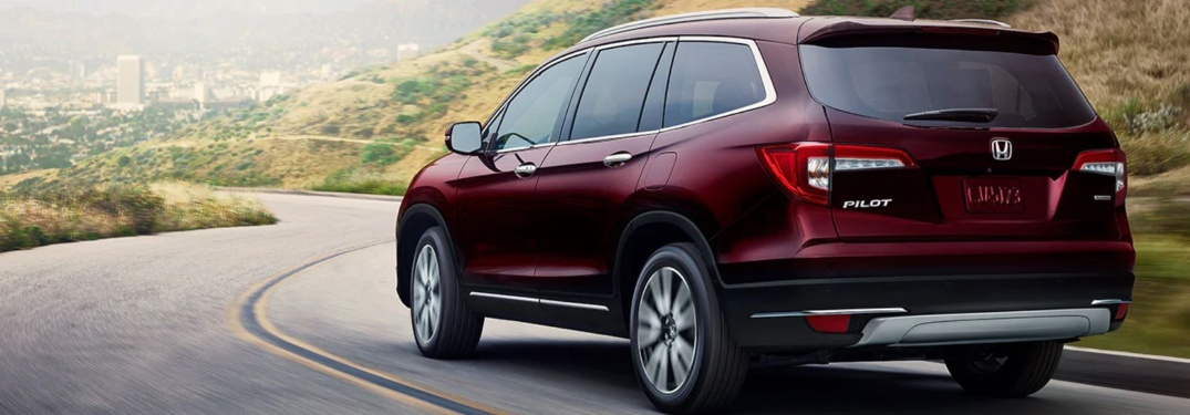 Red 2020 Honda Pilot driving on open road