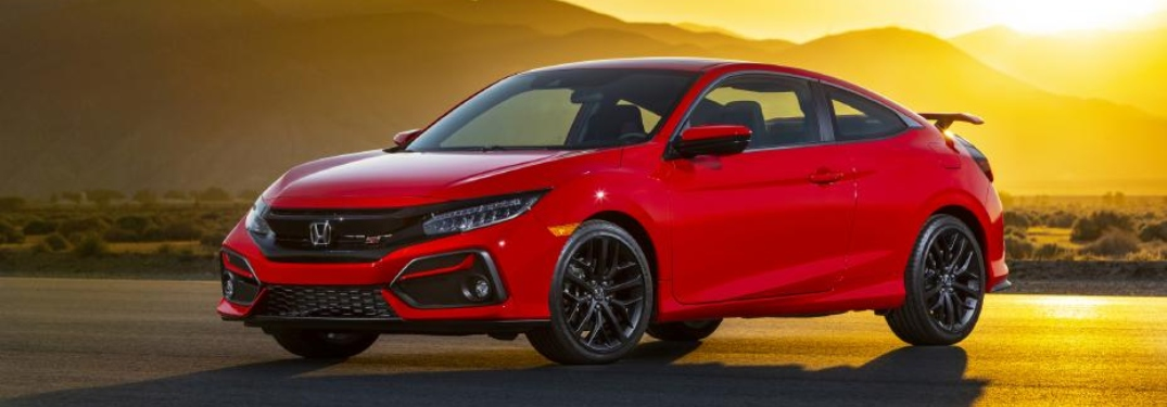 Side view of a red 2020 Honda Civic Si in front of sunset