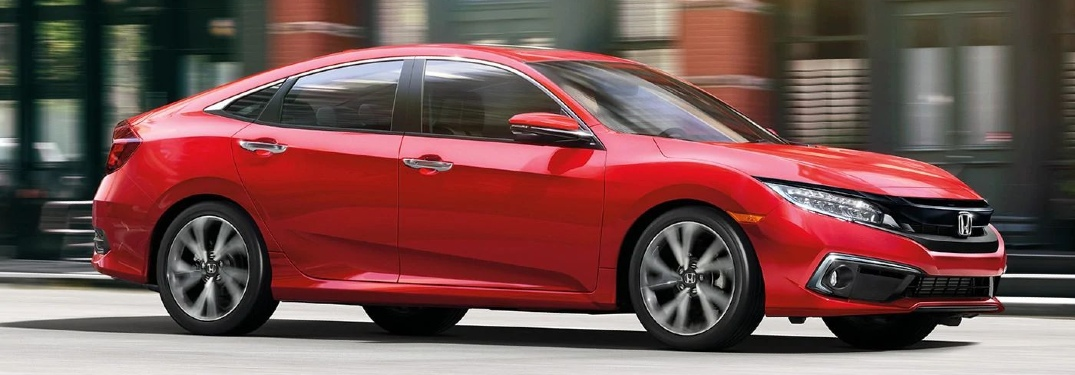 2020 Civic Sedan Touring driving down city street