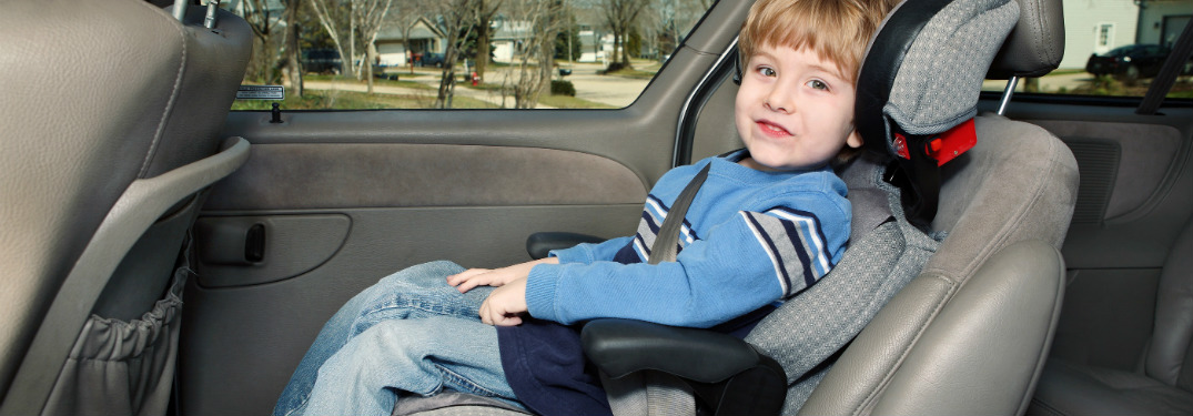 young boy sitting in a car seat