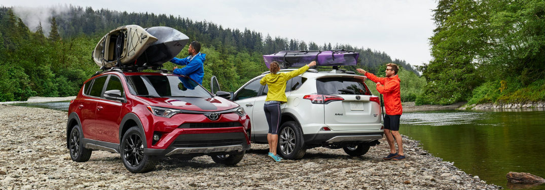 group of friends loading their 2018 Toyta RAV4 models with gear