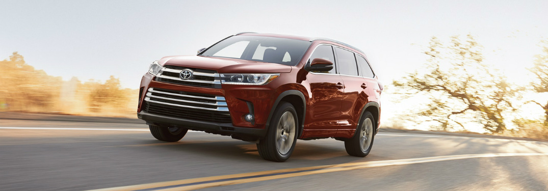 red 2018 Toyota Highlander driving on open road