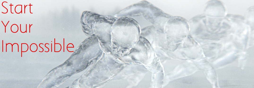 Ice sculptures of Olympic skates with Start Your Impossible text