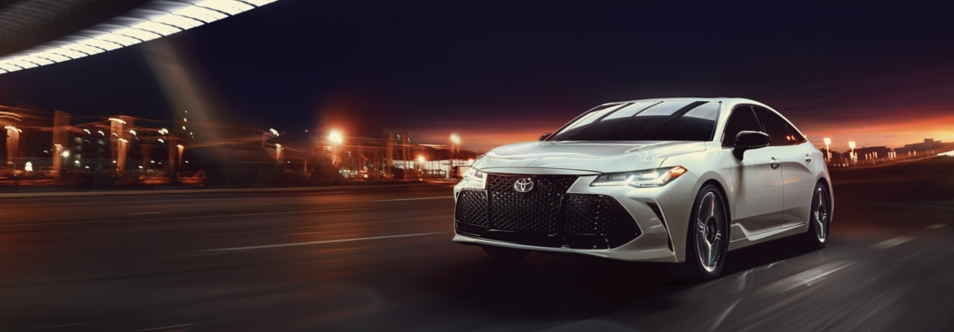 White 2019 Toyota Avalon driving at night