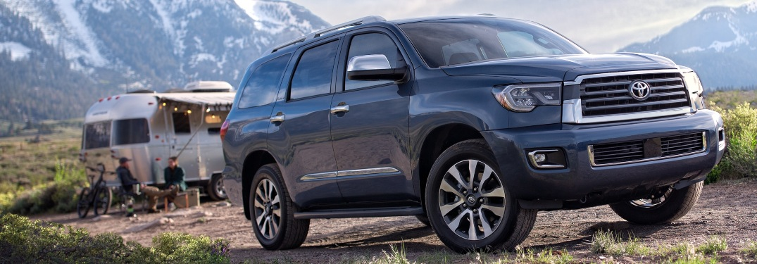 2019 Toyota Sequoia parked by campsite and trailer