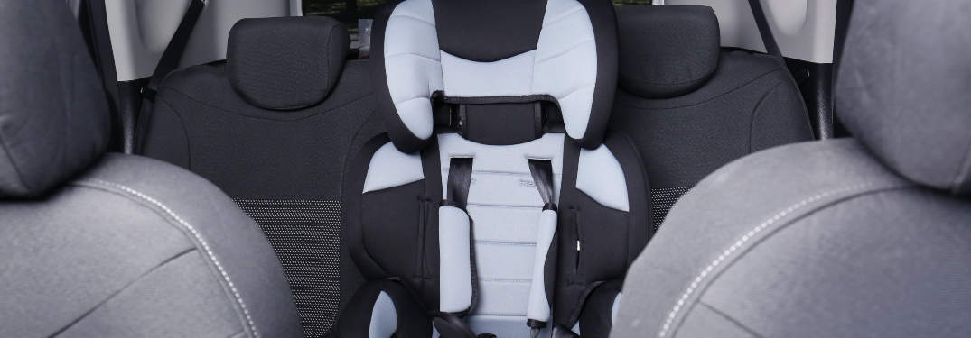 Car seat in the back row of a car