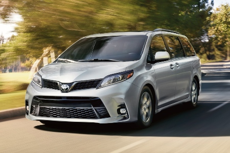 Silver 2020 Toyota Sienna driving on residential street