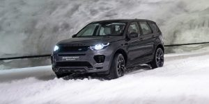Dark Gray 2018 Land Rover Discovery Sport driving through a snow tunnel
