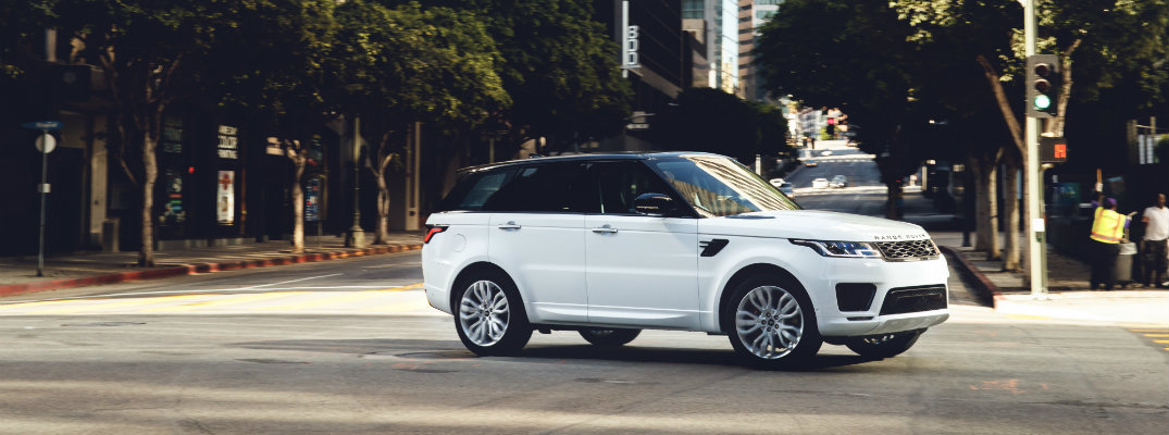 White 2018 Land Rover Range Rover navigating through Los Angeles
