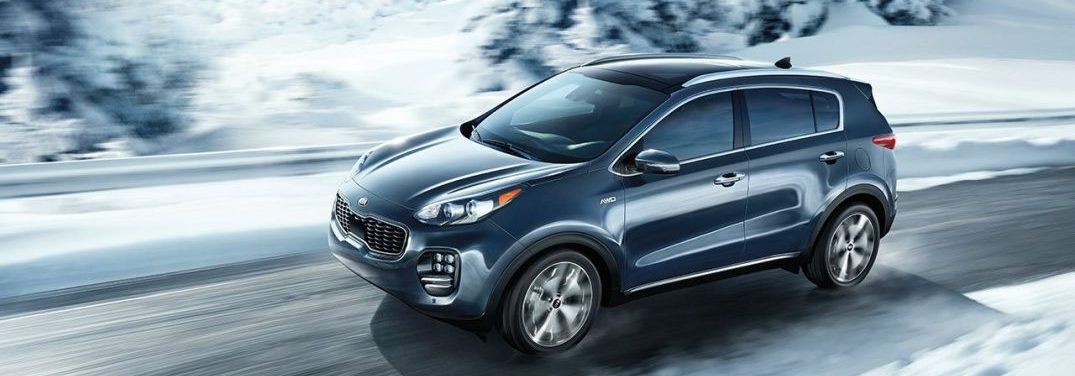 2018 Kia Sportage driving on an icy road