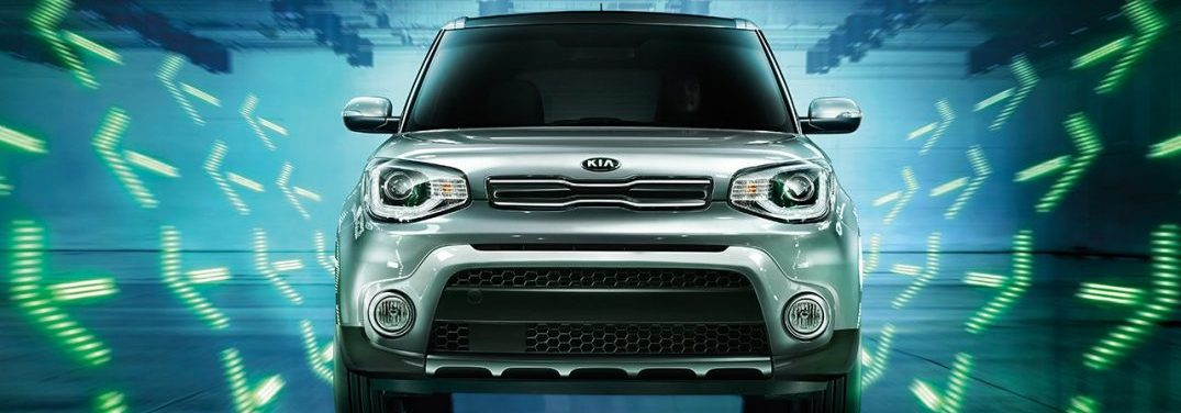 Head on image of the 2018 Kia Soul with green neon arrows in the background
