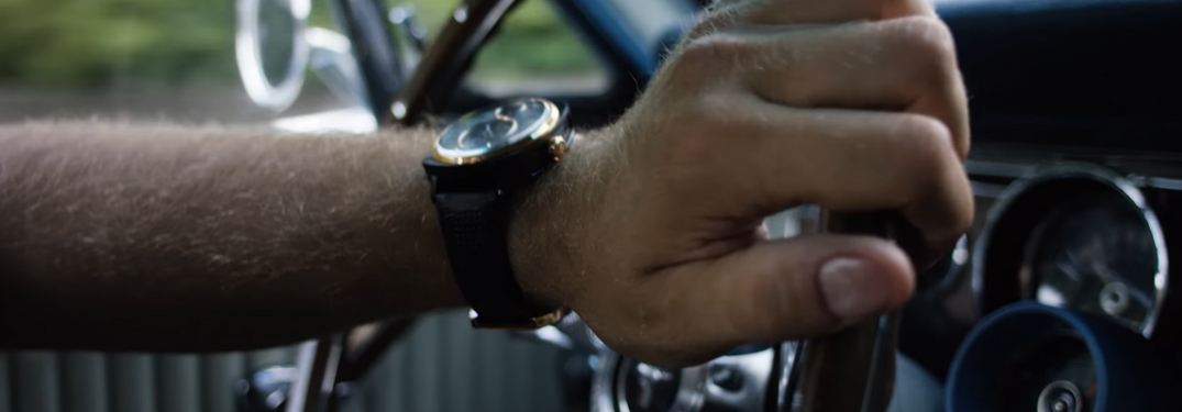 Man with Ford Mustang Watch Driving a Classic Ford Mustang