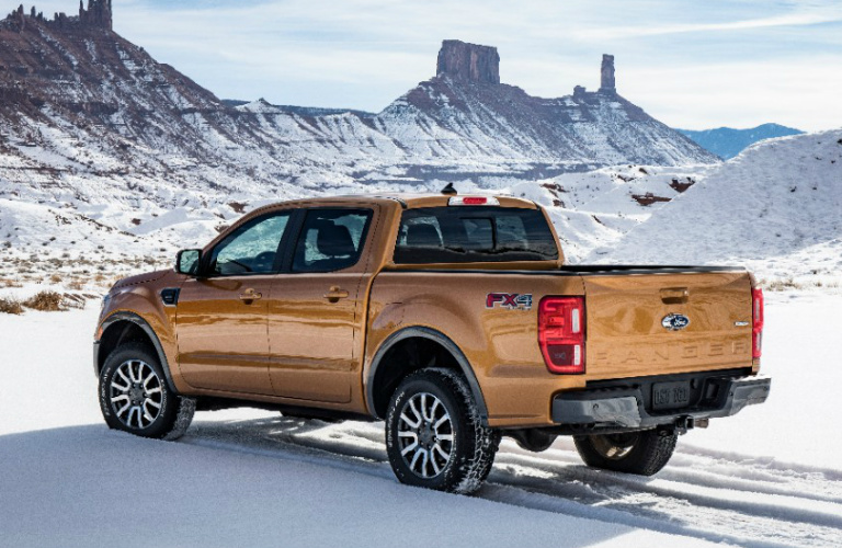 Rear View of Orange 2019 Ford Ranger in Snowy Landscape