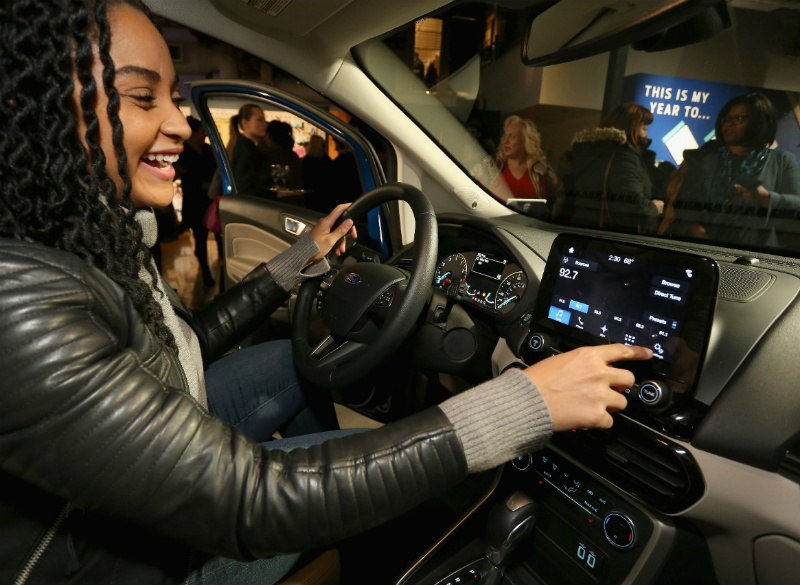 Woman Using Touchscreen in the 2018 Ford EcoSport at the Life Hack Academy