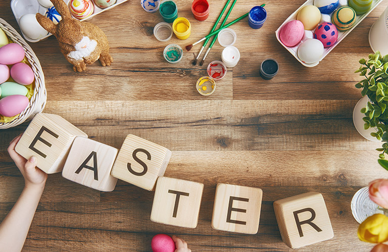 Easter Eggs, Decorating Supplies, and Easter Title on Wood Blocks