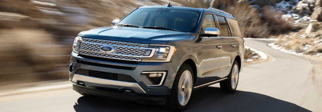 Grey 2018 Ford Expedition Driving on a Mountain Road