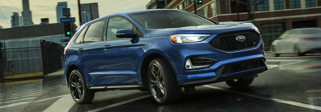 Blue 2019 Ford Edge Driving on a City Street