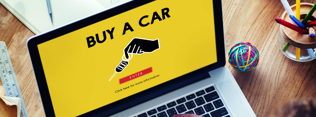 Laptop screen with a buy a car webpage