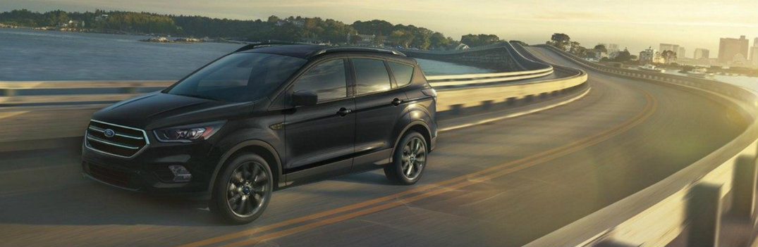 2019 Ford Escape driving past the water