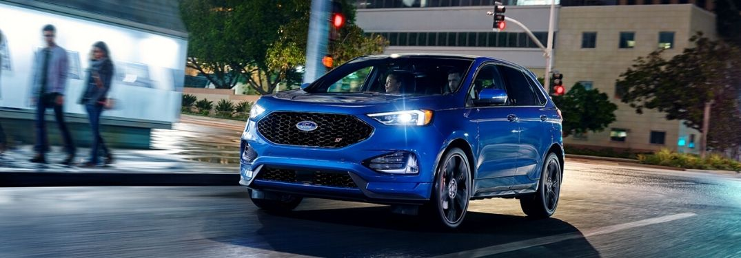 2020 Ford Edge driving on the road at dark
