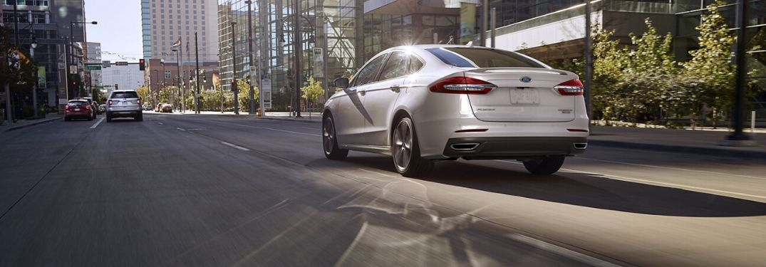 2020 Ford Fusion driving on a road rear view