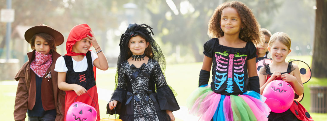 A group of children walking down the street in Halloween costumes 2017 Halloween information for Peters Township, PA