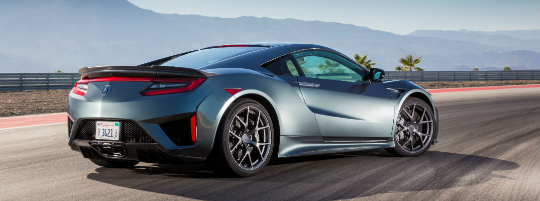 A rear quarter view of an Acura NSX on a racetrack