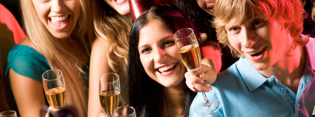 A stock photo of young people celebrating with champagne