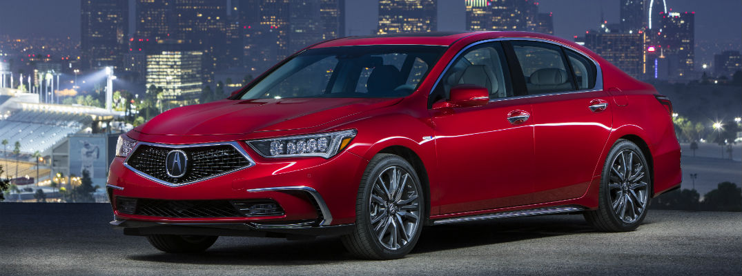 A left quarter view of the 2018 Acura RLX in front of a city skyline.